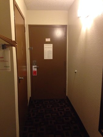 Ramada Tulsa: Entryway and bathroom door