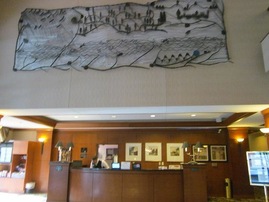 Radisson on John Deere Commons: river themed lobby art above the front desk