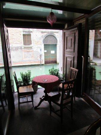 Locanda La Corte : table by the canal in the hotel