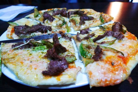 Wood-fired Puka grill pizza at Puka Rumi restaurant, Ollantaytambo