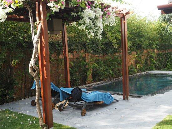 Fusion Maia Da Nang: Lazy setup by the spa villa pool.