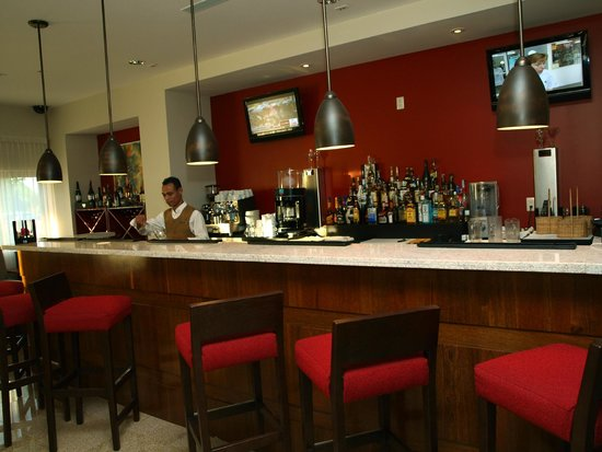 Flavors Restaurant: Flavors features a full service bar and offers weekly specials & happy hour.