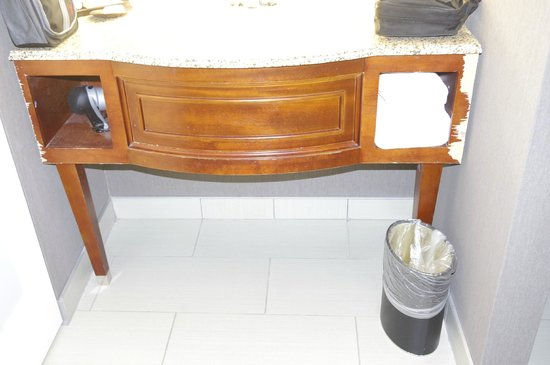 The Burgundy Hotel: Right end of cabinet indicates it was cut out and placed here. Faucet not secured in counter top