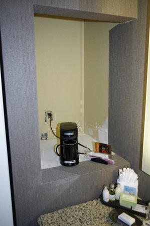 The Burgundy Hotel: Coffeemaker in bathroom unfinished nook. No cover on outlet.