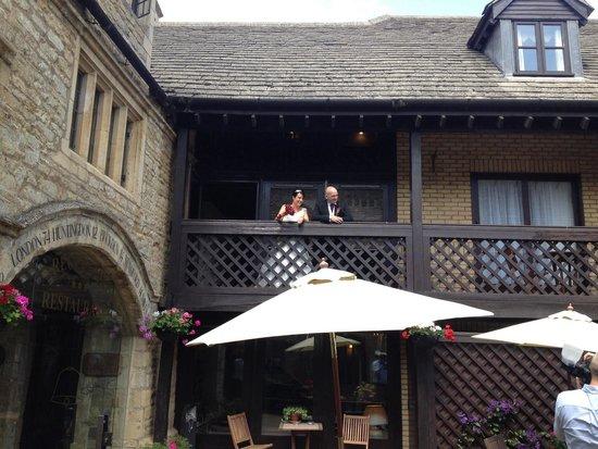 Bell Inn Stilton: Bride and groom on veranda