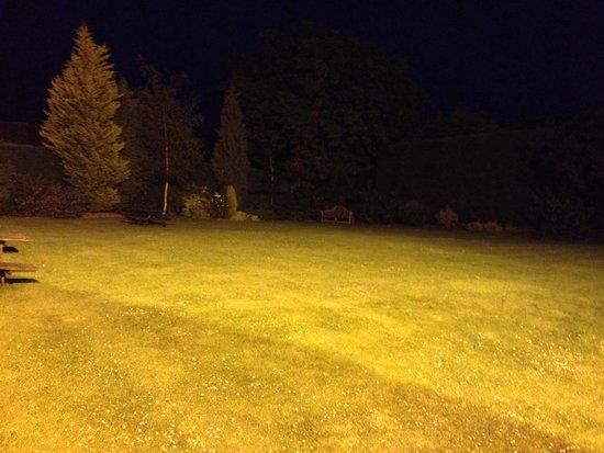Bell Inn Stilton: Rear lawn floodlit at night