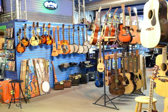 Martin, Taylor, and Gibson Guitars in our Acoustic Room! - Picture