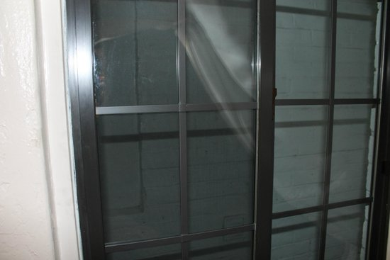 """Tahoe Chalet Inn: Hard to see, but this is the """"view"""" out of the window of the room. The ONLY window in the room."""