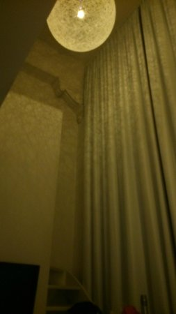 Hotel Arena : huge curtains and the reflection off the light shade.
