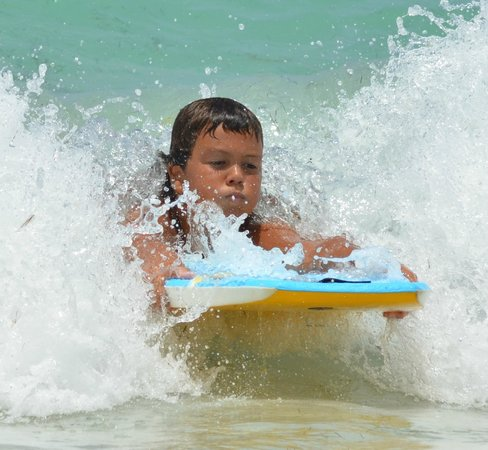 Tri-Sport Eco Tours: Kids love Boogie Boarding at Orient Beach