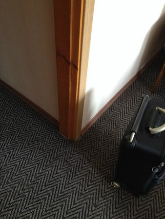 Dzukija Hotel: Skirting board, door frames mismatched not even painted the same colour