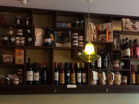 Divino Italian Tapas Restaurant : Wall of wine and oil.