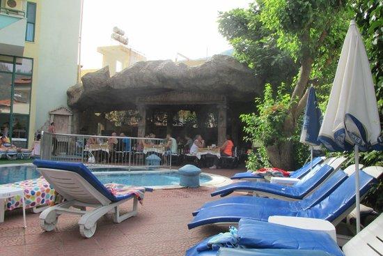 Hotel Siesta: looking from bar area towards restaurant across pool
