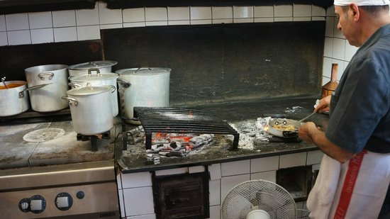 Trattoria Sostanza : Yep - this is the stove top with hot wood coals burning...