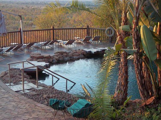 Victoria Falls Safari Lodge: Hotel's pool with views across the bush