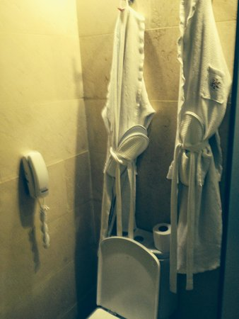 Catalonia Royal Bavaro: Robes and slippers hang over toilet