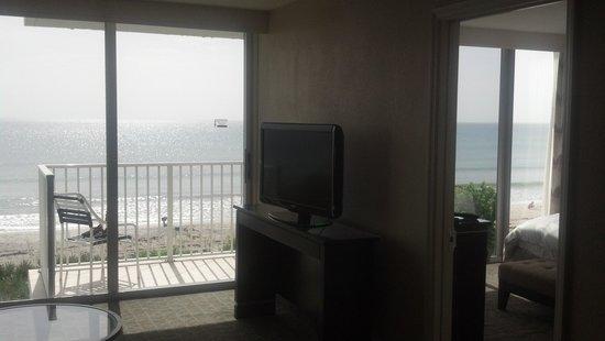Radisson Suite Hotel Oceanfront: Floor to Ceiling Windows - Living Room/Bedroom