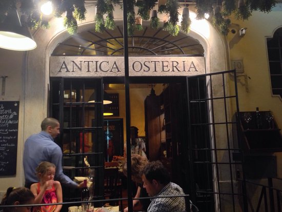 Antica Osteria Brunetti : View from the outside at dusk.