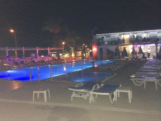 Flora Palm Resort: View of pool at night from our room