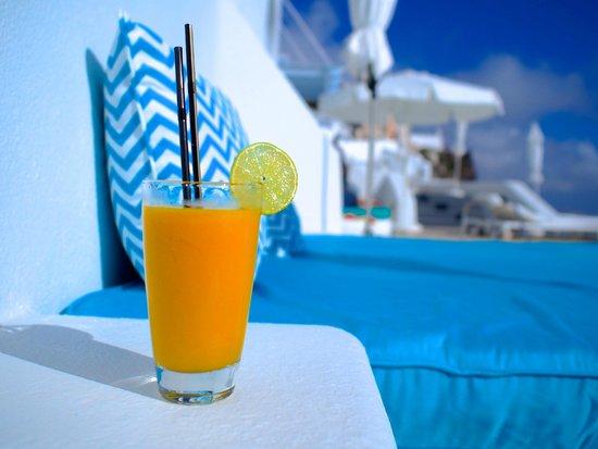 Astra Suites: frozen mango daiquiri served poolside