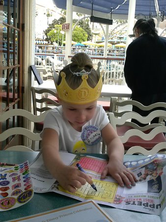 Ariel's Grotto: Enjoying the complimentary crown and coloring book