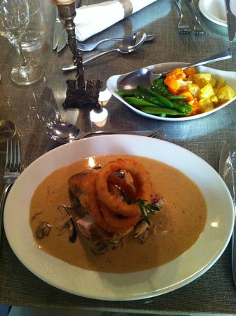 Limestone: My special main course (guinea fowl with wild mushrooms in shallot sauce and onion rings)