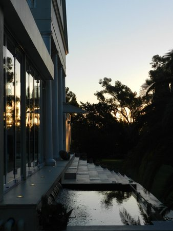 Cascade Manor: The setting sun reflecting against the glass protecting the outdoor dining area.