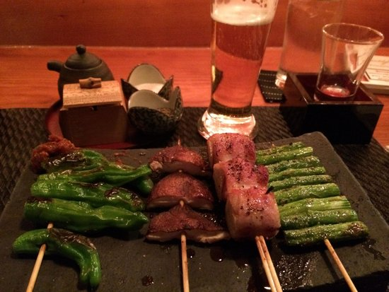 Yakitori Totto : shishito peppers & shiitake & eringi mushrooms in bacon & asparagus