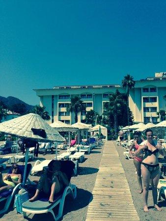 Munamar Beach Hotel: view of private beach walking from sea towards hotel