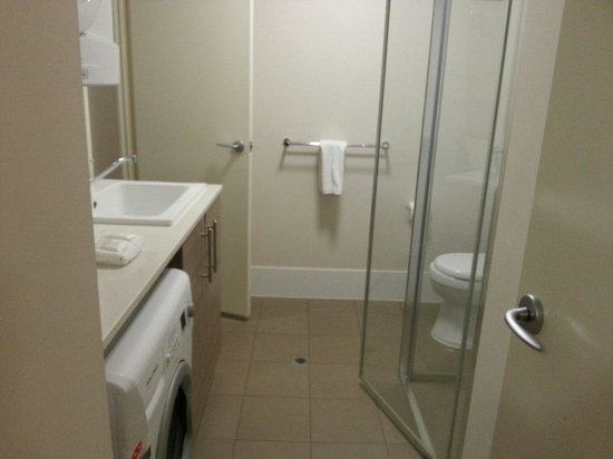 Airport Apartments: common toilet with dryer n washing machine n even packets of washing detergent