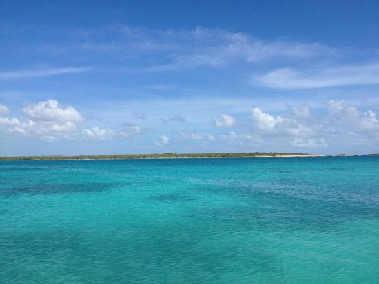 View of the coastline of Antigua from the dock at Stingray City