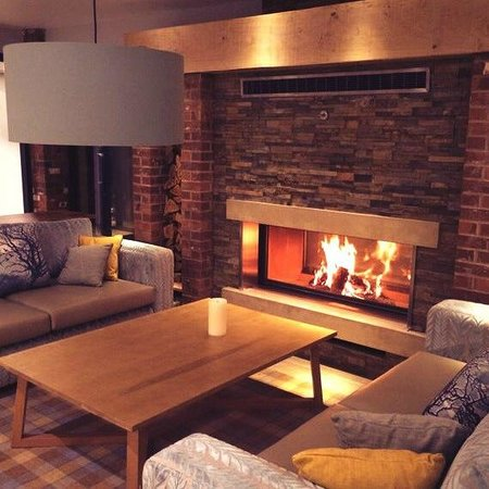 Moddershall Oaks Country Spa Retreat: Cosy Fireplace in Relaxation Lounge