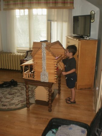 Tintic Goldminers Inn : Grandson playing with log cabin house that was in our room.
