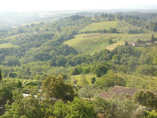 La Cisterna Hotel: Breathtaking views of Tuscany from your balcony.