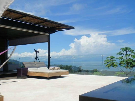 Kura Design Villas Uvita: View from a lounger at the pool