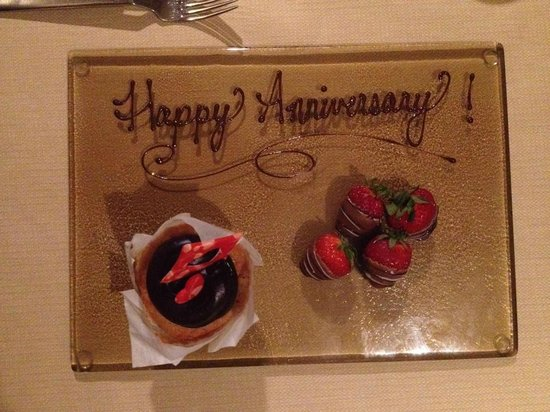 "Four Seasons Hotel Denver: ""Happy Anniversary"" chocolate-covered strawberries & cake"