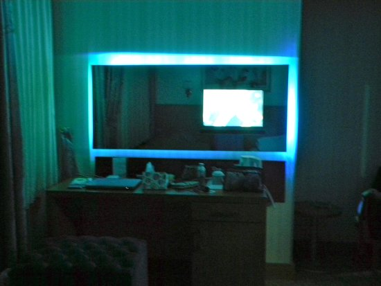 Almina Hotel: Unusual feature of neon lights behind vanity mirror...that housed the TV also.