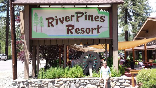 River Pines Resort: My wife in front of the sign.