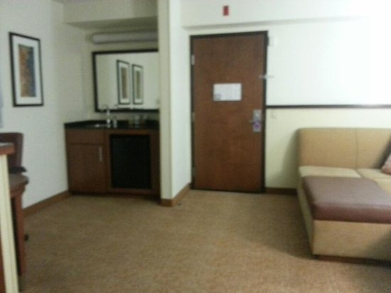 Hyatt Place Las Vegas: sitting area, sink, and work space (to left)