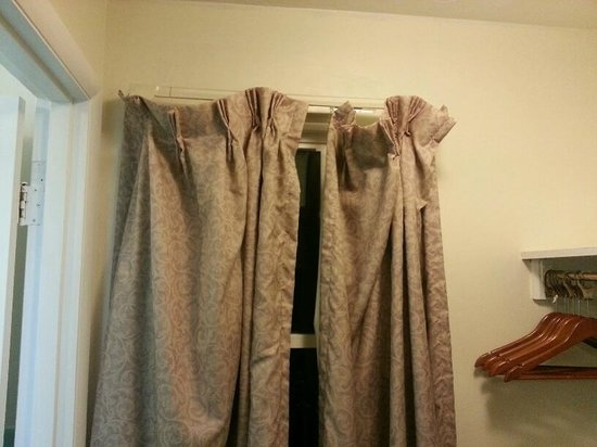 Monticello Motel: Dirty Curtains - Poorly Hung