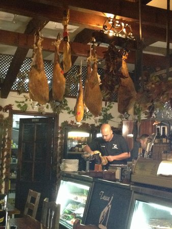 Tasca Casa Paco: The interior and staff Cutting our ham for us!
