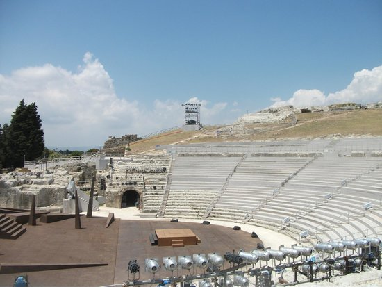 Greek Theater: Greek amphitheatre showing wooden seating and stage