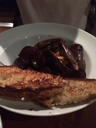 Arturito: Sorry, already started...The Mussel entrée. It was small serve but the mussels are very big and