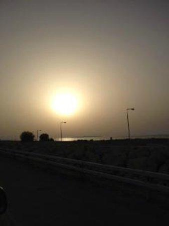 Novotel Bahrain Al Dana Resort: Sun setting near the hotel