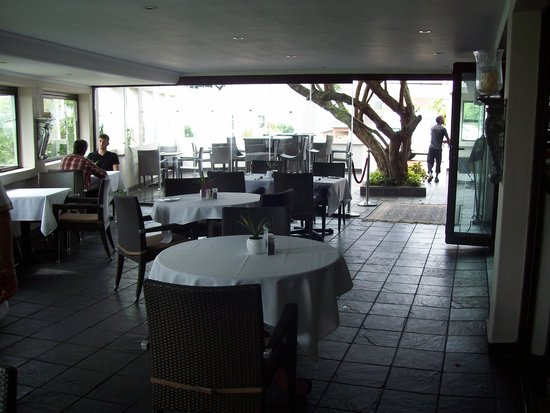 The View Boutique Hotel & Spa: Dining area with a view, inside and outside.
