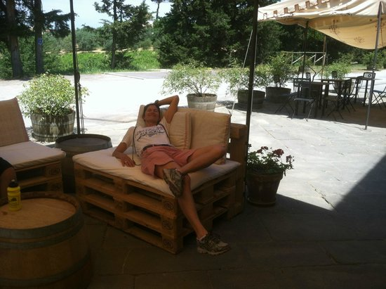 We Like Tuscany: Our guide, Jill, relaxing in the shade at the winery.