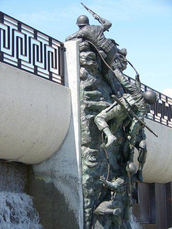 National D-Day Memorial: Depicting Soldiers climbing up the cliffs off  Normandy Beach