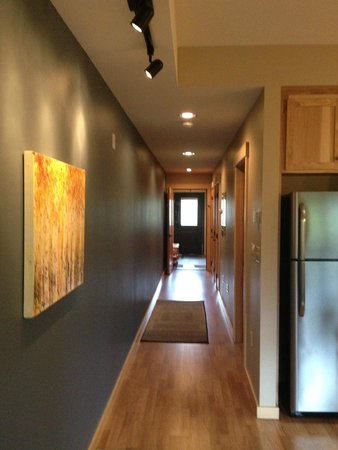 Twisp River Suites: hall way with art leads to each bedroom
