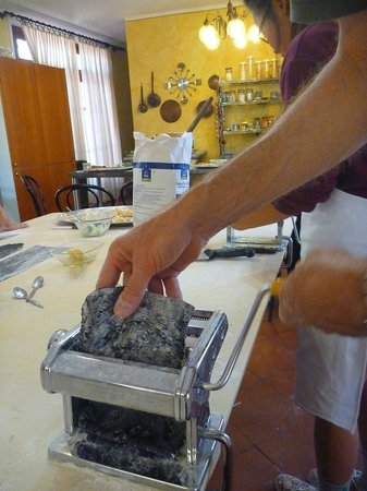 Chef Paolo Monti's Cucina Italiana Cooking School : Rolling out squid-ink pasta for fettuccine