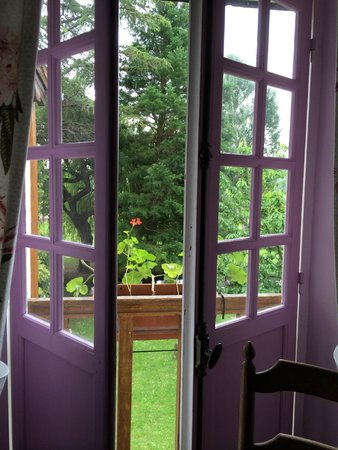 Moulin des Chennevieres: View out french doors and mill race from the Lilac room.